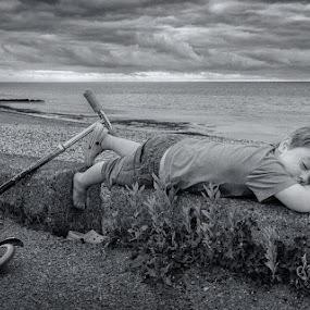 Taking a Break by Dan Horton-Szar ARPS - Black & White Portraits & People ( monochrome, reculver, black and white, kent, sea, children, sleeping, seaside, beach, sleep, coast, family, outdoors, boy, scooter )