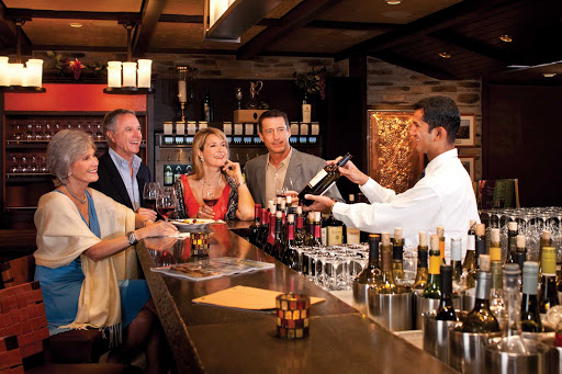 Freedom-of-the-Seas-Vintages-wine-bar - Share a bottle, or take a class, at Freedom of the Seas' Vintages wine bar.