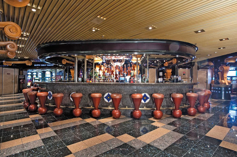 Stop by the Violins Bar for cool drinks, live music and ocean views on your next Carnival Inspiration cruise to Mexico.