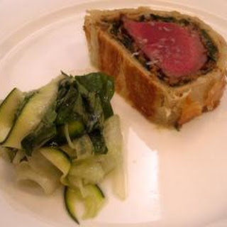 Beef Wellington with a summer salad.