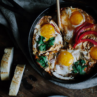Eggs Fried With Tomatoes And Goat Cheese.