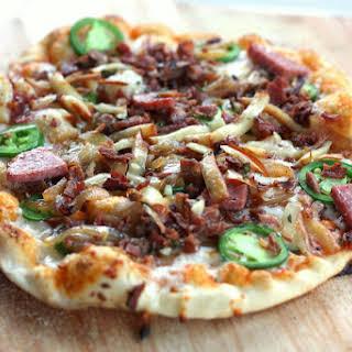 Bacon Jalapeno Sausage Pizza with Sriracha Sauce.
