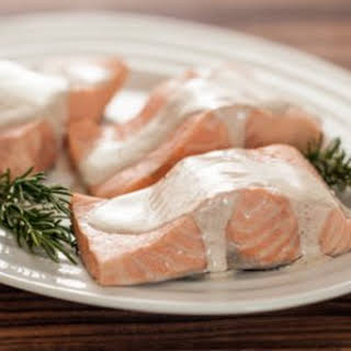 Rosemary Poached Salmon with Spiced Cream Sauce.