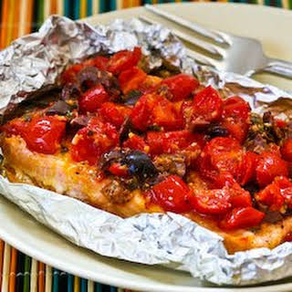 Grilled Salmon Packets with Tomatoes, Olives, Garlic, Thyme, and Saffron.