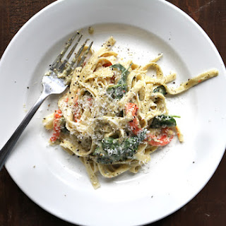 Fettuccine with Pesto Cream Sauce, Roasted Red Peppers, and Spinach.