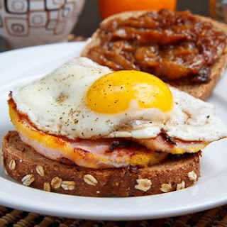 Peameal Bacon Breakfast Sandwich with Maple Caramelized Onions and a Fried Egg.