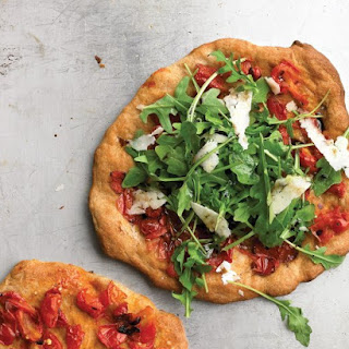 Individual Pizza with Arugula and Tomatoes