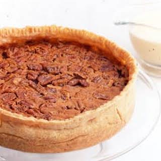 Pumpkin-Pecan Pie with Whiskey Butter Sauce.