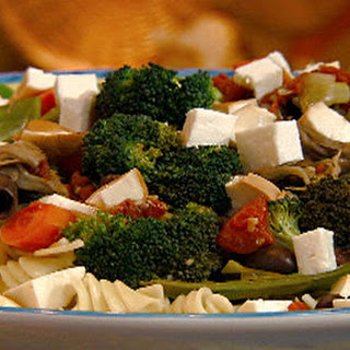 Pasta Spirals With Sauteed Vegetables, Olives And Smoked Mozzarella.