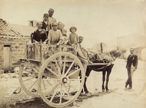 Group portrait in traditional dress from Palermo, up the Sicilian cart