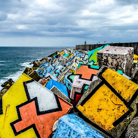 Cubes of Memory by Justin Murazzo - Artistic Objects Other Objects ( europe, colorful, block, visit, ocean, beauty, yellow, coastline, coast, spain, dock, grey, marina, austurias, cement, artist, painting, black, clouds, water, orange, agustín ibarrola, biscay, green, waves, beautiful, art, white, sea, tourism, paint, gray, llanes, concrete, red, iberia, bay, blue, color, cantabrian, symmetry, cube, design, peninsula,  )