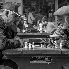 Chess game by Amro Labib - People Street & Candids ( natural light, relax, black and white, simple, street, white, chess, play, game, fun, win, street photography, blackandwhite, lose, nature up close, streets, daylight, smart, black )