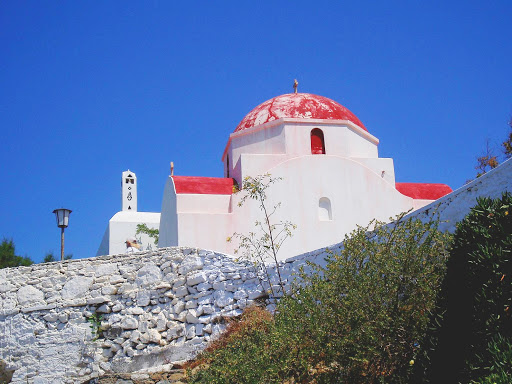 A Greek Orthodox Church sitting atop a hill on the Greek isle of Mykonos.