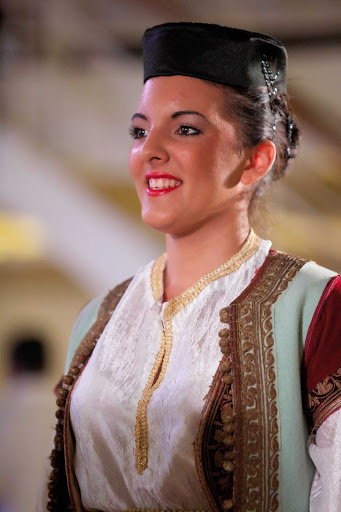 Azamara-performer - A performer in traditional garb during a show on an  Azamara cruise.