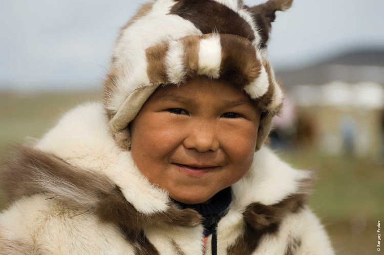 Meet local villagers like this boy in Chukotka, Russia, across the Bering Sea from Alaska, when you sail on Silver Discoverer.
