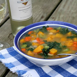 Butternut Squash and Kale Soup with Fresh Herbs and White Beans.