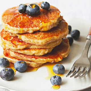 Paleo Pancakes With Berries And Maple Syrup