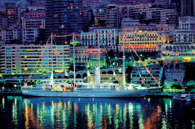 Windstar's Wind Surf gleams at night in the Monte Carlo harbor.