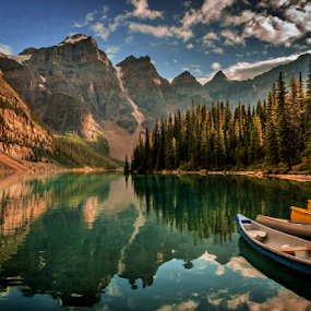 Moraine Lake by Joseph Law - Landscapes Waterscapes ( clouds, national park, blue sky, bushes, boats, rocky mountains, reflections, trees, banff, moraine lake,  )