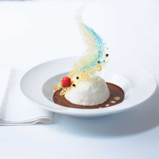 Blu Chocolate Floating Island with Orange Blossom Creme Anglaise - Can a dessert be a work of art? The Blu Chocolate Floating Island with Orange Blossom Crème Anglaise at Celebrity's Blu restaurant.