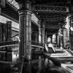 Deansgate, Manchester, UK by Bianca Mauro - City,  Street & Park  Street Scenes ( water, contrast, uk, black and white, deansgate, stone, bridge, manchester, city )