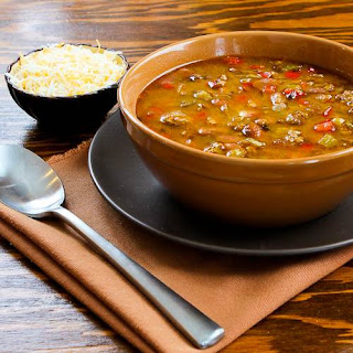 Spicy Slow Cooker Soup with Ground Turkey, Pinto Beans, Red Bell Pepper, and Green Chiles.