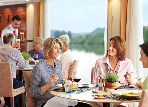 Viking-Longship-Restaurant-2 - Dine with friends and drink in the breathtaking views of Europe's waterways as you cruise aboard a Viking Longship.