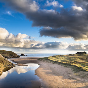 Winter beach walk by Brian Miller - Landscapes Beaches ( clouds, wales, pembrokeshire, reflections, beach )