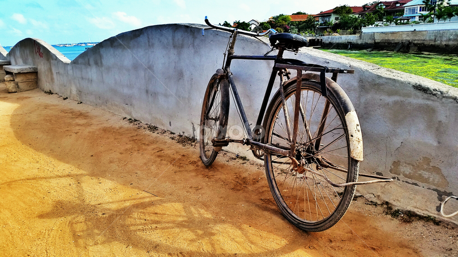 A dusty road by Werner Booysen - Transportation Bicycles ( old, s5, samsung, tanzania, werner booysen, dusty, bicycle,  )