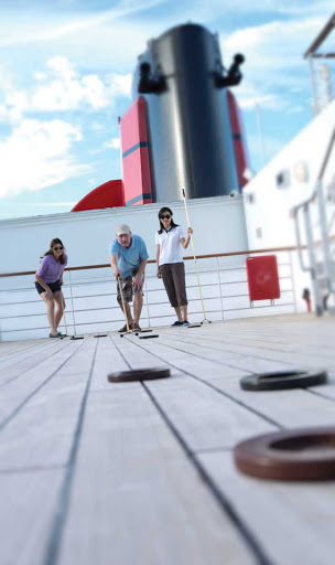 Cunard-Queen-Mary-2-shuffleboard - Is shuffleboard your thing? Soak in the beautiful weather and play a game on Queen Mary 2's Game Deck.