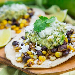 Caramelized Corn and Black Bean Tacos with Roast Zucchini Salsa and Roasted Poblano Crema.