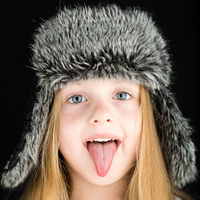 by Dirk Sachse - Babies & Children Child Portraits ( girl, cap, fur, children, tonque, portrait )