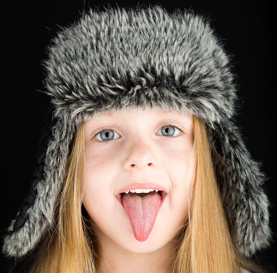 by Dirk Sachse - Babies & Children Child Portraits ( girl, cap, fur, children, tonque, portrait )
