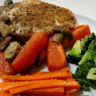 Roasted Pork Chops with Tomatoes, Mushrooms, and Garlic Sauce.
