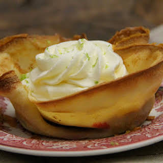 Crepe Tartlets with Raspberries and Whipped Cream.