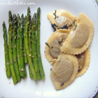 Mushroom Ravioli with Garlic-Sage Brown Butter and Asparagus.