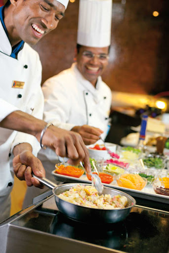 Carnival-Cruise-Lines-dining-Chefs-Table-cooks - Revel in a multicourse dinner prepared by the master chefs of Chef's Table during your Carnival cruise.