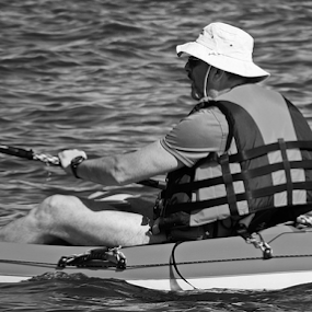 A man in a boat by Renato Dibelčar - Black & White Sports ( izola, slovenia, summer, sea, sommer, mann, boat, meer, man )