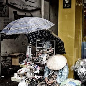 Vendor by Matt Hulland - People Street & Candids ( stall, street vendor, umbrella, vietnam, sleeping )