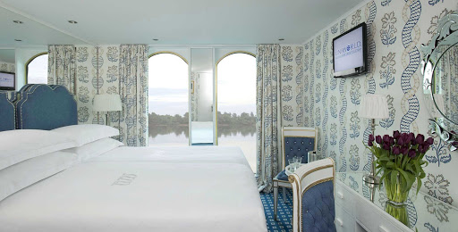 Uniworld-River-Queen-stateroom-window - Stay in River Queen's regal stateroom while you discover the enchanting cities and spectacular scenery of Europe.