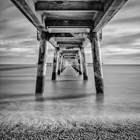 Under Deal Pier by Dan Horton-Szar ARPS - Buildings & Architecture Bridges & Suspended Structures ( water, clouds, monochrome, kent, waves, long-exposure, black & white, sea, beach, seaside, coast, deal, pier,  )