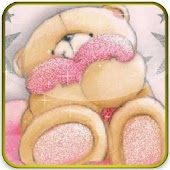 teddy bear embrace pink pillow