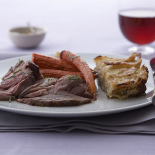 Herb-Roasted Leg of Lamb with Vegetables and Jus.