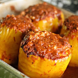 Cheesy, Stuffed Mexican Peppers With Red Chili Sauce.