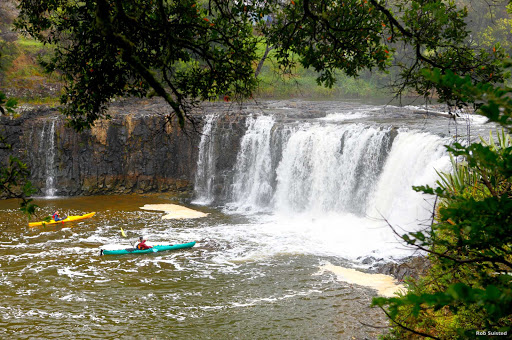 Haruru_Falls_Bay_of_Islands - The Haruru Falls were created by an ancient lava flow. You can reach the falls by road, walking track or sea kayak from historic Waitangi in the Bay of Islands. The walking track includes native forest and a boardwalk through a tidal mangrove forest. Local guided kayak tours offer full tuition and an informative commentary along the way.