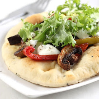 Curried vegetable flatbreads with Greek yogurt.