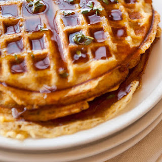 Cornmeal-Bacon Waffles with Thyme-Infused Maple Syrup.