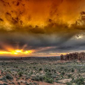 Golden Suset by Jim Salvas - Landscapes Sunsets & Sunrises ( clouds, arches national park, utah, sunset, arches, gold, rays )