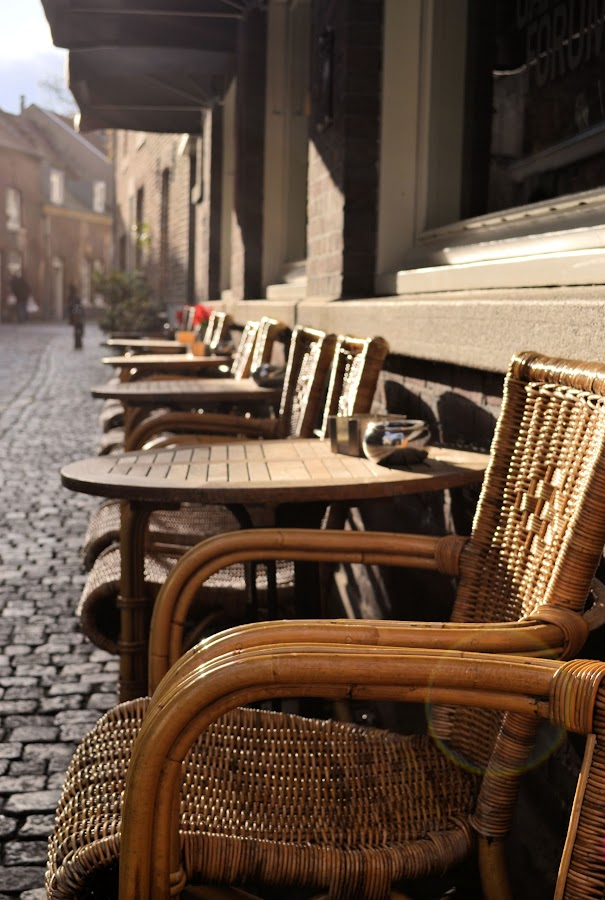 Sunday afternoon by Heather Aplin - City,  Street & Park  Street Scenes ( chair, wicker, cobbled, street, sunlight, , Chair, Chairs, Sitting )