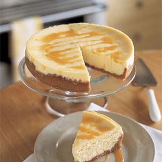 Mascarpone Cheesecake with Roasted Cashew Crust and Passion Fruit Caramel Sauce.